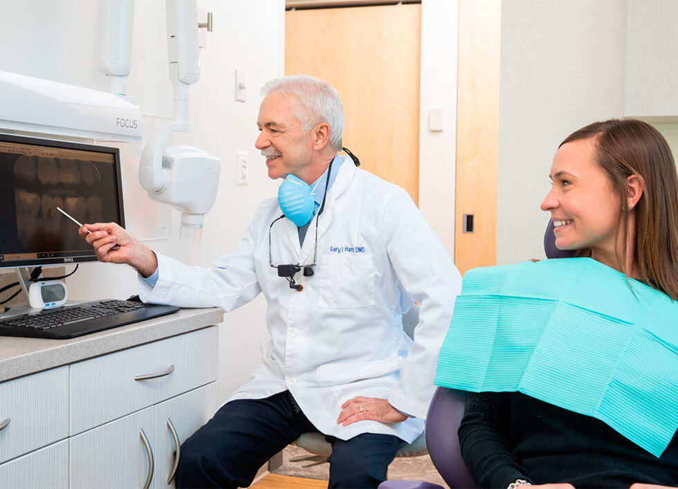 Our dentist in Reston showing a digital x-ray to a female patient
