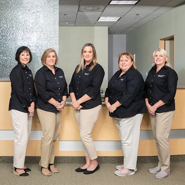 Some of our Ashburn team in front of the office smiling as they wear their work uniform