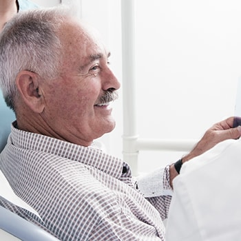 Old patient smiling in a shirt