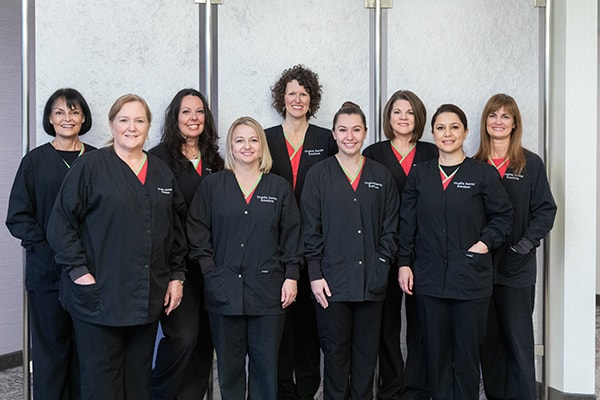All our Reston dentistry team smiling while wearing their uniform