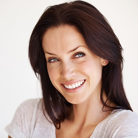 A woman looking to the side and smiling