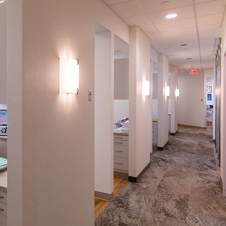 The hallway of one of our dental offices showing the different surgical rooms